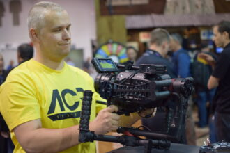 <p>Max Salamonowicz with The Beast Gimbal at NAB booth 2015.</p>
